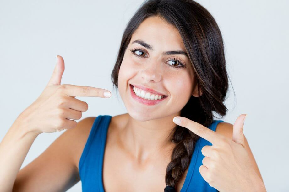 Cosmetic Dentistry Patient Smiling With Straight, White Teeth